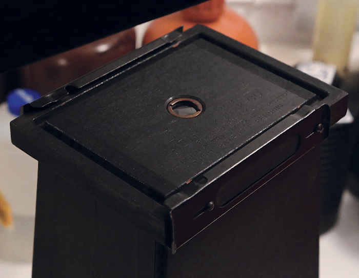 The mid-section of the No. 2 Brownie Enlarging Camera where the lens is.