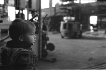 Toddler at an industrial site.