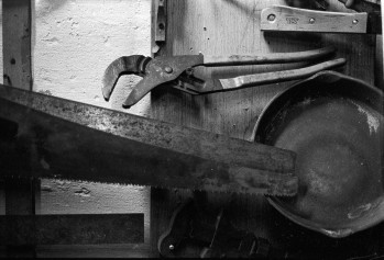 An adjustable wrench and a saw