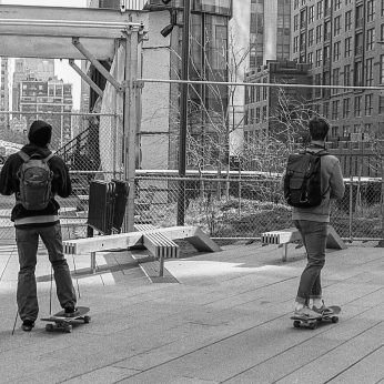2 guys on high line w/skateboards and they both had cameras in their hands