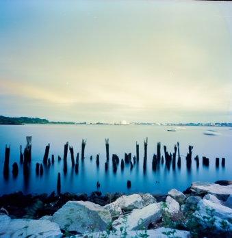 Zero Image Pinhole, Kodak Ektar, Providence River. These dock remnants seem to worship the light under which they reside.